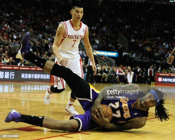 Jeremy Lin of the Houston Rockets looks down to Jordan Hill of the Los Angeles Lakers during the game at the Toyota Center on January 8 2014 in...