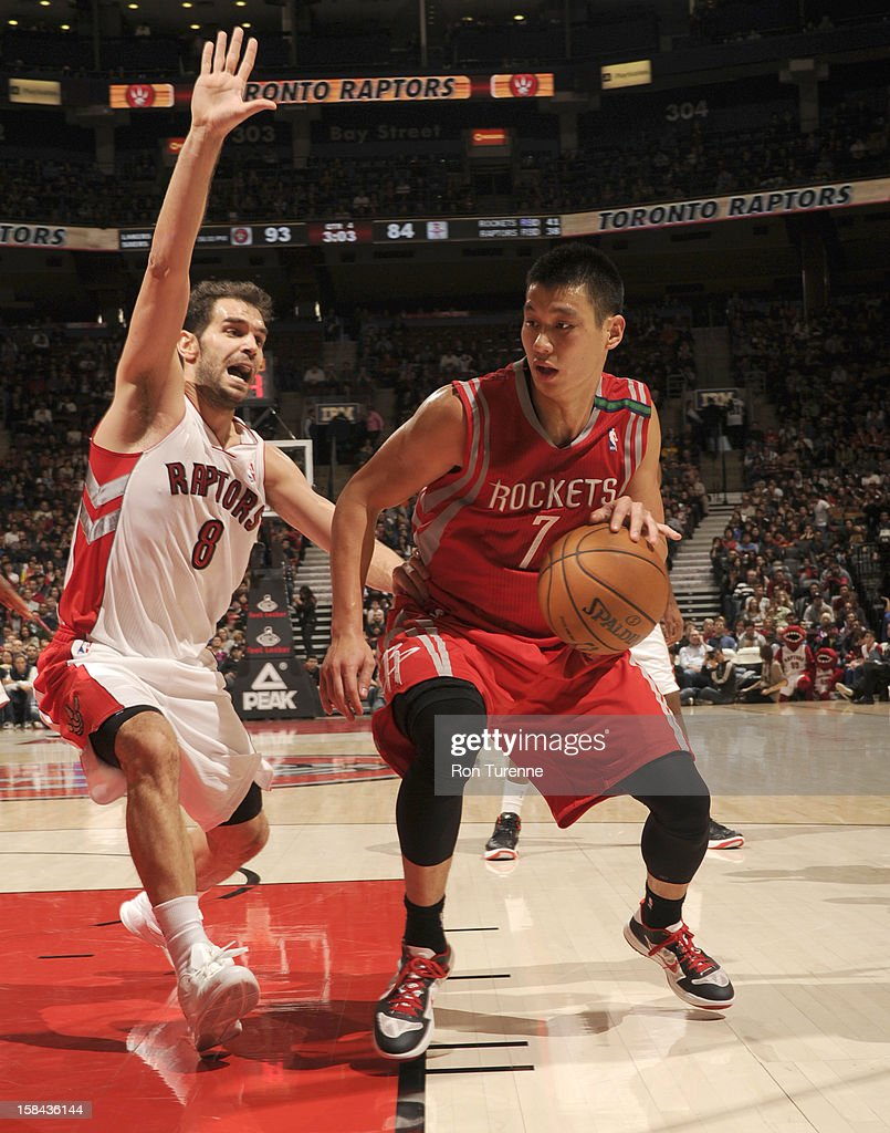 Jeremy Lin #7 of the Houston Rockets protects the ball from Jose Calderon #8 of the Toronto Raptors during the game between the Toronto Raptors and the Houston Rockets December 16, 2012 at the Air Canada Centre in Toronto, Ontario, Canada.