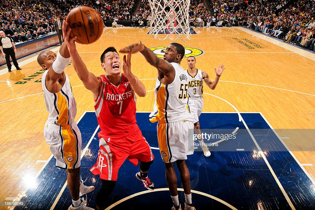 Jeremy Lin #7 of the Houston Rockets shoots a layup against David West #21 and Roy Hibbert #55 of the Indiana Pacers on January 18, 2013 at Bankers Life Fieldhouse in Indianapolis, Indiana.