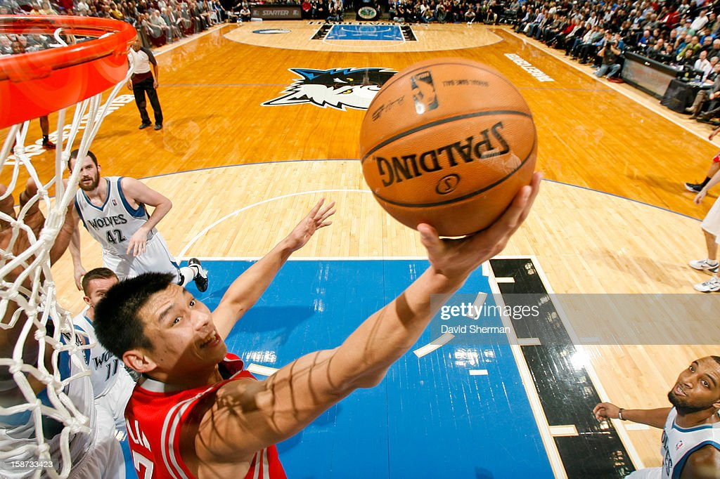 Jeremy Lin #7 of the Houston Rockets shoots a reverse layup against the Minnesota Timberwolves on December 26, 2012 at Target Center in Minneapolis, Minnesota.