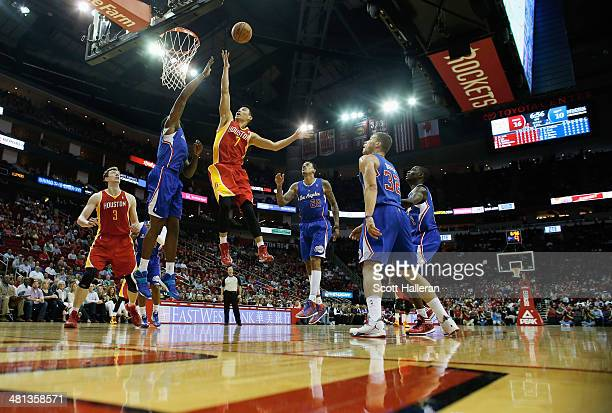 Jeremy Lin of the Houston Rockets shoots over DeAndre Jordan of the Los Angeles Clippers during the game at the Toyota Center on March 29 2014 in...