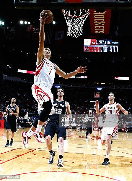 Jeremy Lin of the Houston Rockets shoots over Tiago Splitter of the San Antonio Spurs at Toyota Center on March 24, 2013 in Houston, Texas. NOTE TO...