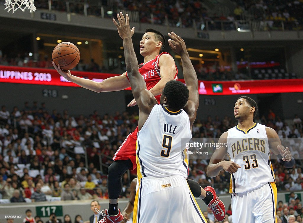 Jeremy Lin #7 of the Houston Rockets shoots past Solomon Hill #9 and Danny Granger #33 of the Indiana Pacers during the NBA game at the Mall of Asia Arena on October 10, 2013 in Manila, Philippines.