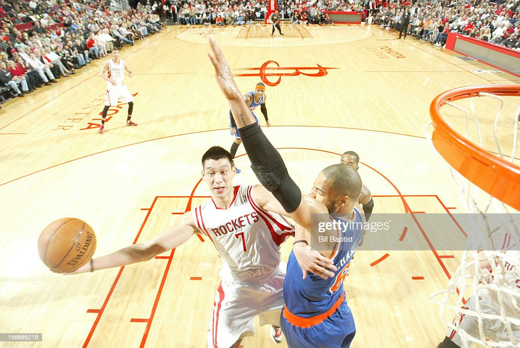 Jeremy Lin #7 of the Houston Rockets shoots the ball over Tyson Chandler #6 of the New York Knicks on November 23, 2012 at the Toyota Center in Houston, Texas.
