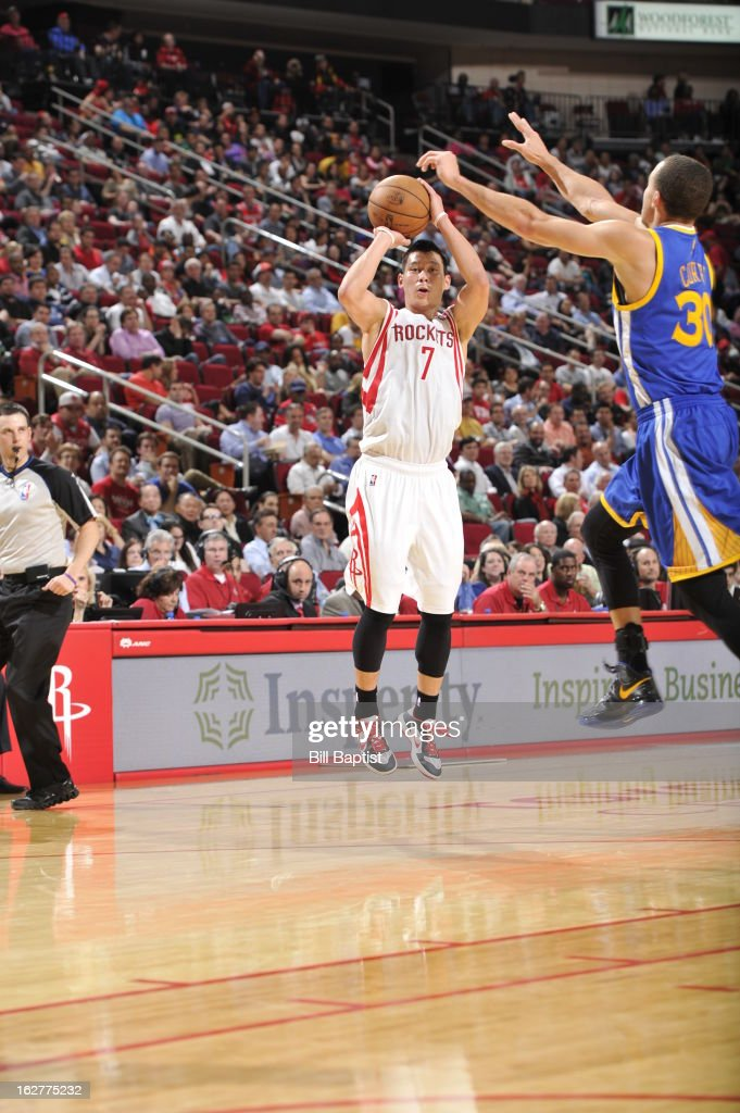 Jeremy Lin #7 of the Houston Rockets takes a shot against the Golden State Warriors on February 5, 2013 at the Toyota Center in Houston, Texas.