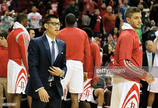 Jeremy Lin of the Houston Rockets waits near the bench after being injured earlier in the week during the game at Toyota Center on November 29 2013...