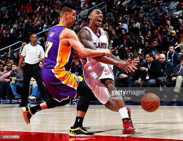 Jeremy Lin of the Los Angeles Lakers fouls Jeff Teague of the Atlanta Hawks at Philips Arena on November 18 2014 in Atlanta Georgia NOTE TO USER User...