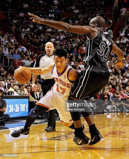 Jeremy Lin of the New York Knicks drives against Joel Anthony of the Miami Heat during a game at American Airlines Arena on February 23 2012 in Miami...