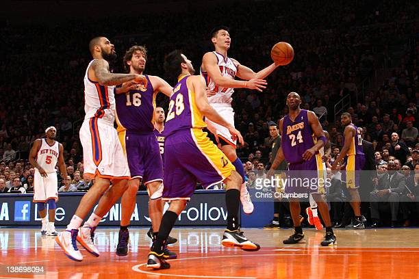 Jeremy Lin of the New York Knicks drives for a shot attempt in the fourth quarter against Jason Kapono and Kobe Bryant of the Los Angeles Lakers at...