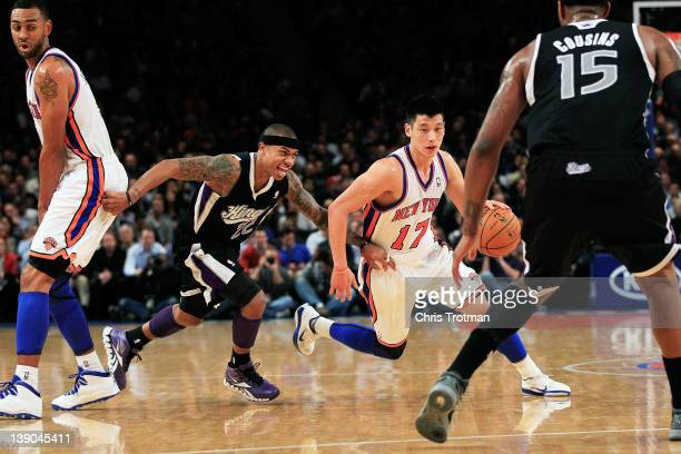 Jeremy Lin of the New York Knicks drives past Isaiah Thomas of the Sacramento Kings at Madison Square Garden on February 15 2012 in New York City...