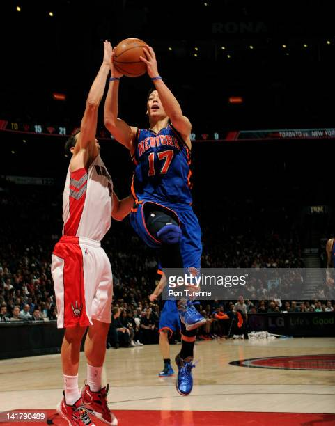 Jeremy Lin of the New York Knicks drives to the basket against Jose Calderon of the Toronto Raptors on March 23 2012 at the Air Canada Centre in...