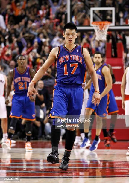 Jeremy Lin of the New York Knicks reacts after a gamewinning threepointer over Jose Calderon of the Toronto Raptors at the Air Canada Centre February...