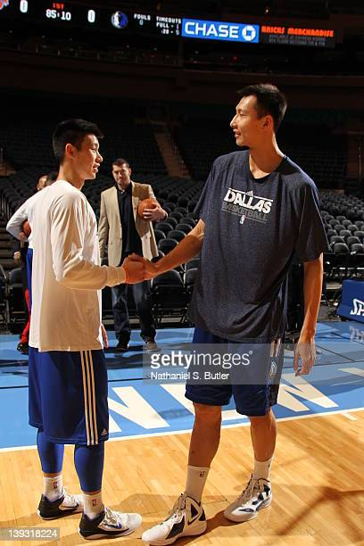 Jeremy Lin of the New York Knicks shakes hands with Yi Jianlian of the Dallas Mavericks prior to the game on February 19 2012 at Madison Square...