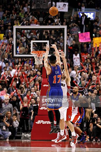 Jeremy Lin of the New York Knicks shoots a gamewinning threepointer over Jose Calderon of the Toronto Raptors at the Air Canada Centre February 14...