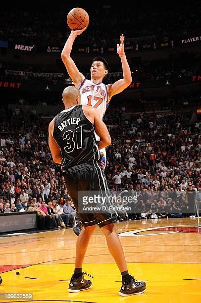 Jeremy Lin of the New York Knicks takes a jump shot over Shane Battier of the Miami Heat during the game on February 23, 2012 at American Airlines...
