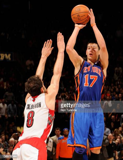 Jeremy Lin of the New York Knicks takes the game winning three pointer against Jose Calderon of the Toronto Raptors on February 14 2012 at the Air...