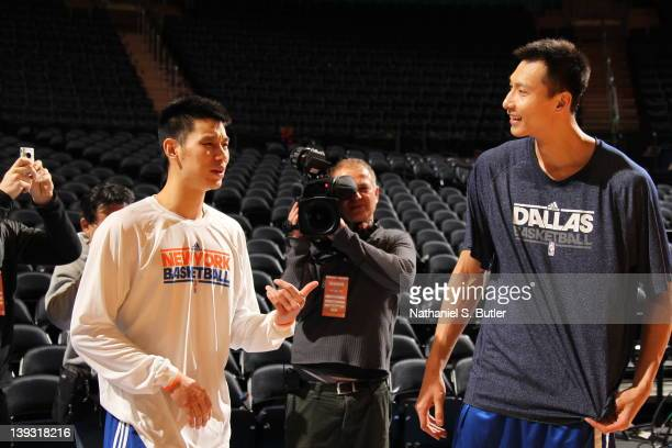 Jeremy Lin of the New York Knicks talks with Yi Jianlian of the Dallas Mavericks prior to the game on February 19 2012 at Madison Square Garden in...