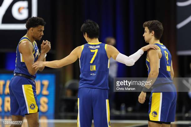 Jeremy Lin of the Santa Cruz Warriors talks with teammates during the NBA G League Playoffs on March 8, 2021 at HP Field House in Orlando, Florida....
