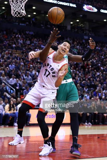 Jeremy Lin of the Toronto Raptors battles for the ball with Jaylen Brown of the Boston Celtics during the second half of an NBA game at Scotiabank...