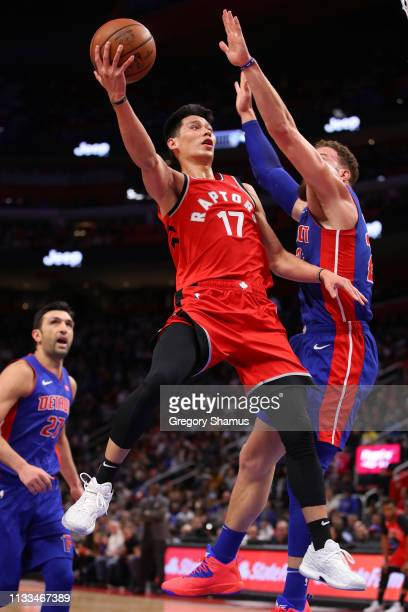 Jeremy Lin of the Toronto Raptors dives to the basket around Blake Griffin of the Detroit Pistons during the first half at Little Caesars Arena on...