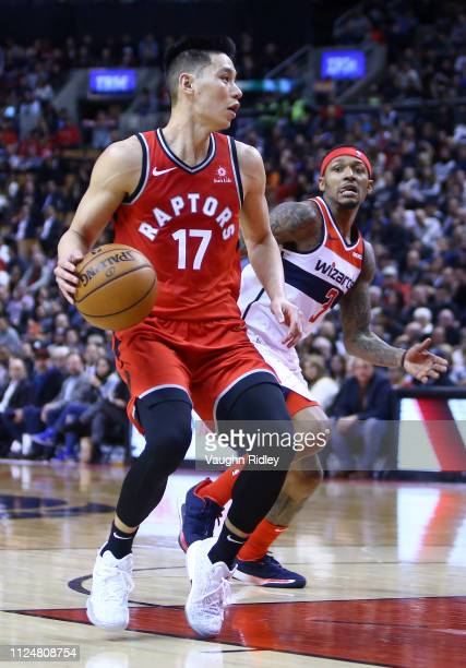 Jeremy Lin of the Toronto Raptors dribbles the ball as Bradley Beal of the Washington Wizards defends during the second half of an NBA game at...