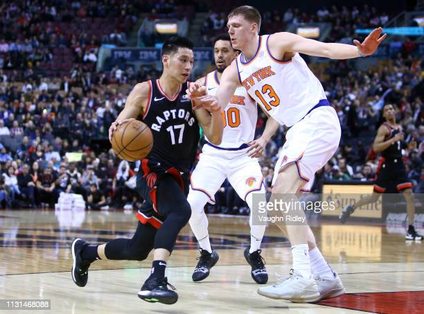 Jeremy Lin of the Toronto Raptors dribbles the ball as Henry Ellenson of the New York Knicks defends during the second half of an NBA game at...