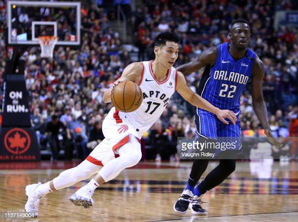 Jeremy Lin of the Toronto Raptors dribbles the ball as Jerian Grant of the Orlando Magic defends during the second half of an NBA game at Scotiabank...