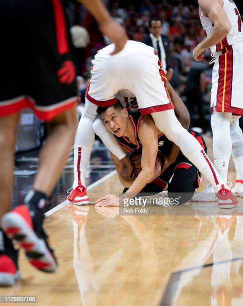 Jeremy Lin of the Toronto Raptors fights for a loose ball beneath Hassan Whiteside of the Miami Heat during the first half of the game at American...