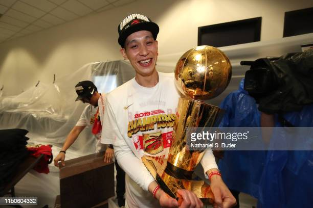 Jeremy Lin of the Toronto Raptors holds the Larry O'Brien Championship Trophy in the locker room after defeating the Golden State Warriors in Game...