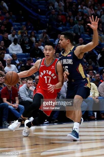 Jeremy Lin of the Toronto Raptors is defended by Frank Jackson of the New Orleans Pelicans during the second half at the Smoothie King Center on...