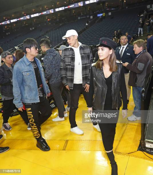Jeremy Lin of the Toronto Raptors, Jay Chou and Hannah Quinlivan walk off the court after Game Four of the NBA Finals against the Golden State...