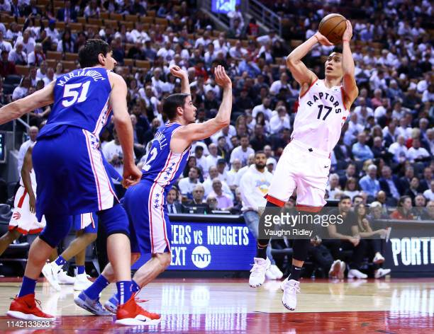 Jeremy Lin of the Toronto Raptors shoots the ball as T.J. McConnell of the Philadelphia 76ers defends in the second half during Game Five of the...