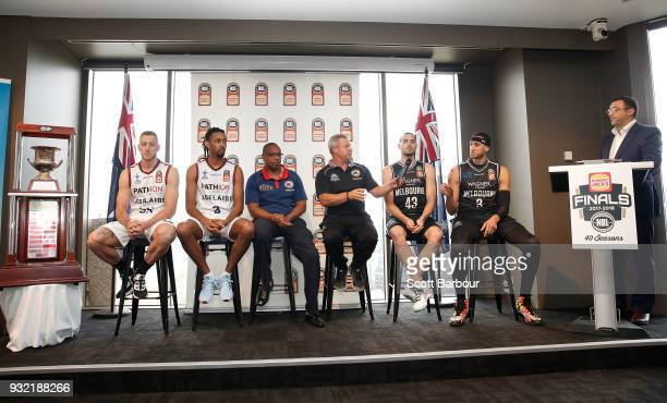 Jeremy Loeliger speaks as coach Dean Vickerman Josh Boone and Chris Goulding of Melbourne United along with Mitch Creek Josh Childress and coach Joey...
