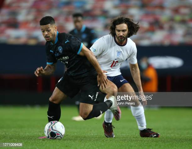 Jeremy Lynch of England in action with Joe Wicks of Rest of the World during the Soccer Aid for Unicef 2020 match between England and Rest of the...