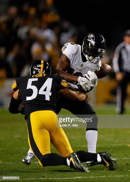 Jeremy Maclin of the Baltimore Ravens is hit by LJ Fort of the Pittsburgh Steelers after a catch in the fourth quarter during the game at Heinz Field...