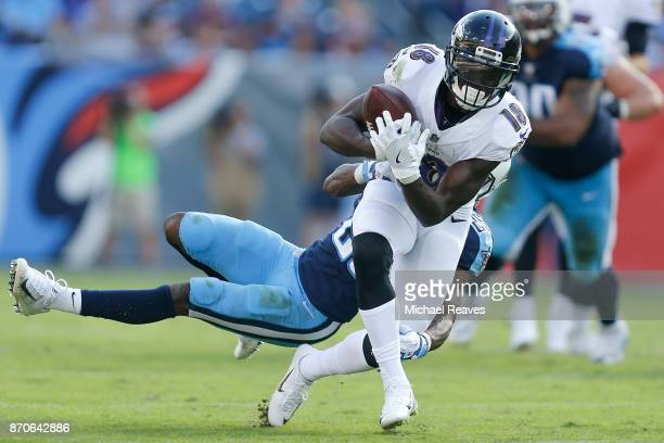 Jeremy Maclin of the Baltimore Ravens is tackled by Adoree' Jackson of the Tennessee Titans during the second half at Nissan Stadium on November 5...