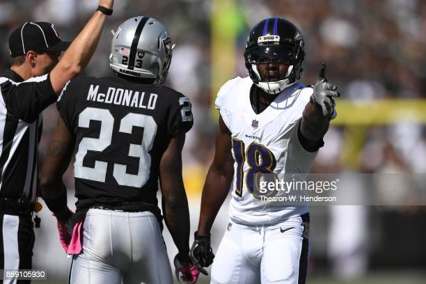 Jeremy Maclin of the Baltimore Ravens reacts after a catch against the Oakland Raiders during their NFL game at OaklandAlameda County Coliseum on...