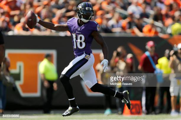 Jeremy Maclin of the Baltimore Ravens runs the ball into the end zone for a touchdown during the second quarter of the game against the Cincinnati...