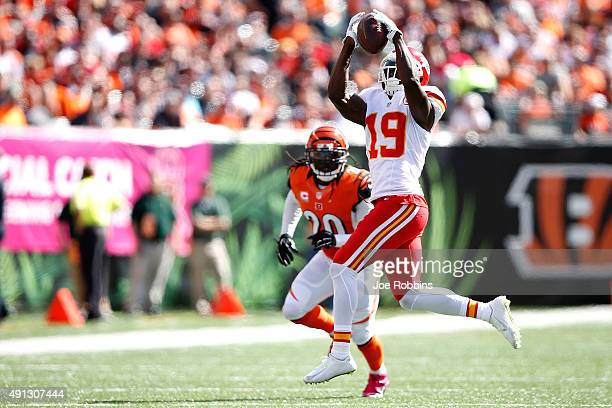 Jeremy Maclin of the Kansas City Chiefs catches a pass in front of Reggie Nelson of the Cincinnati Bengals during the second quarter at Paul Brown...