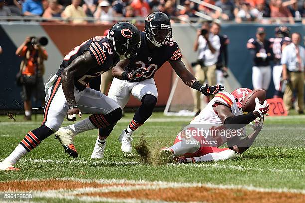 Jeremy Maclin of the Kansas City Chiefs catches a pass in front of Harold JonesQuartey and Demontre Hurst of the Chicago Bears during a preseason...