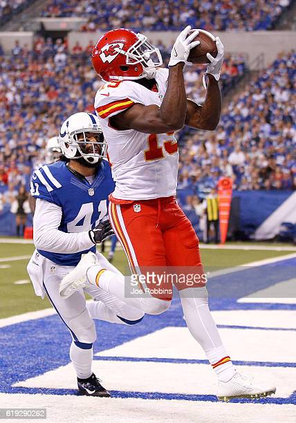 Jeremy Maclin of the Kansas City Chiefs catches a touchdown pass while being guarded by Matthias Farley of the Indianapolis Colts during the second...