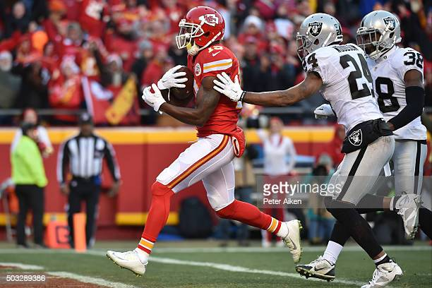 Jeremy Maclin of the Kansas City Chiefs catches the first touchdown of the game between Charles Woodson of the Oakland Raiders and teammate TJ Carrie...