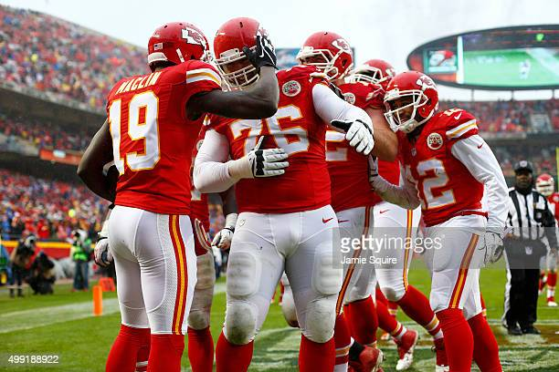 Jeremy Maclin of the Kansas City Chiefs celebrates a touchdown reception with teammate Laurent DuvernayTardif at Arrowhead Stadium during the second...