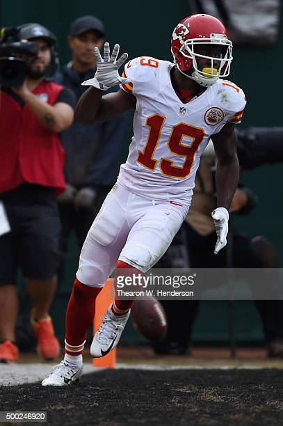 Jeremy Maclin of the Kansas City Chiefs celebrates after a 13yard touchdown pass from Alex Smith during their NFL game against the Oakland Raiders at...