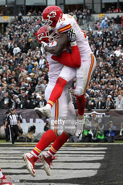 Jeremy Maclin of the Kansas City Chiefs celebrates with Jah Reid after a 13yard touchdown pass from Alex Smith during their NFL game against the...