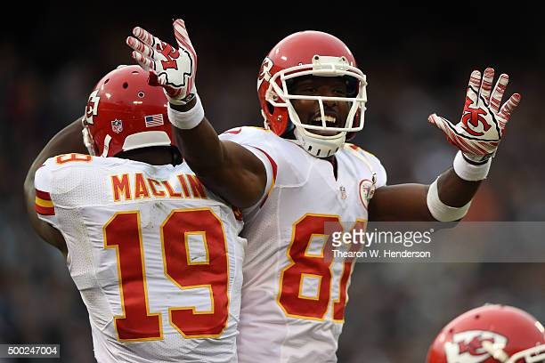 Jeremy Maclin of the Kansas City Chiefs celebrates with Jason Avant after a 1yard touchdown pass from Alex Smith during their NFL game against the...