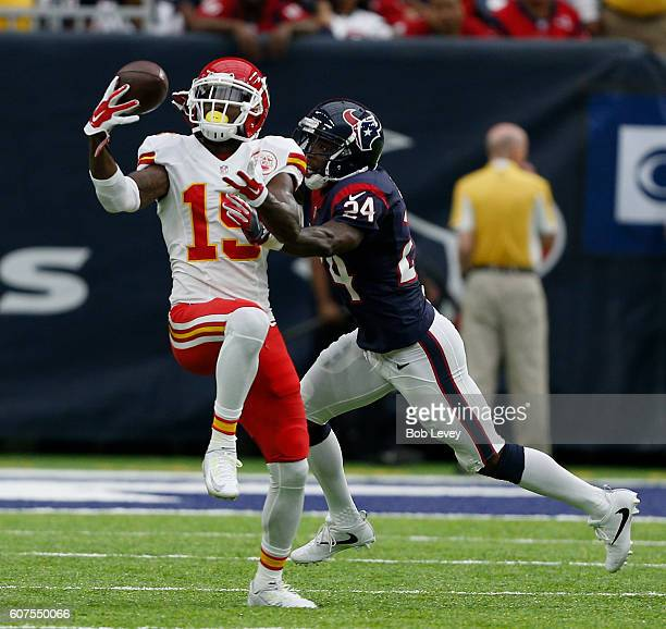 Jeremy Maclin of the Kansas City Chiefs makes a catch as Johnathan Joseph of the Houston Texans makes the tackle in the first half at NRG Stadium on...