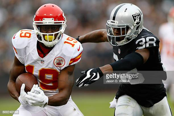 Jeremy Maclin of the Kansas City Chiefs makes a catch in front of TJ Carrie of the Oakland Raiders during their NFL game at Oco Coliseum on December...