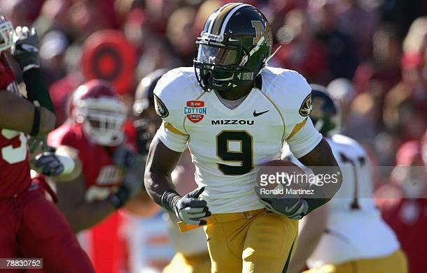 Jeremy Maclin of the Missouri Tigers carries the ball during the ATT Cotton Bowl Classic against the Arkansas Razorbacks on January 1 2008 at the...
