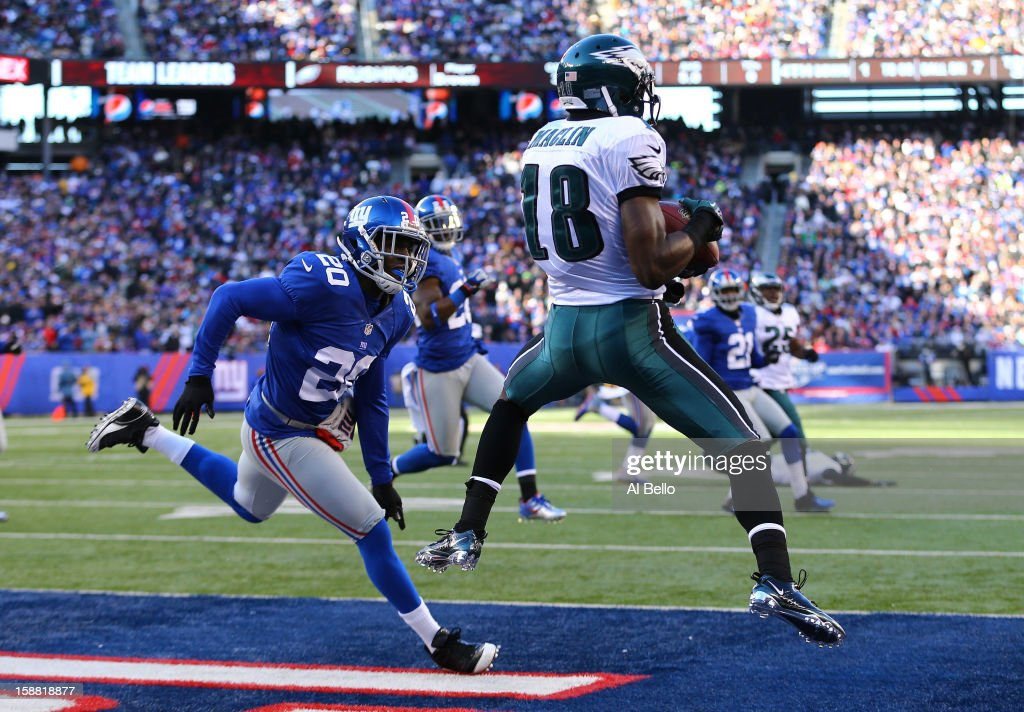 Jeremy Maclin #18 of the Philadelphia Eagles catches a touchdown during their game against Prince Amukamara #20 of the New York Giants at MetLife Stadium on December 30, 2012 in East Rutherford, New Jersey.